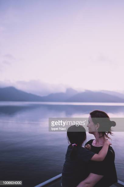 Mother and little girl enjoying view together at sunset, Nikko