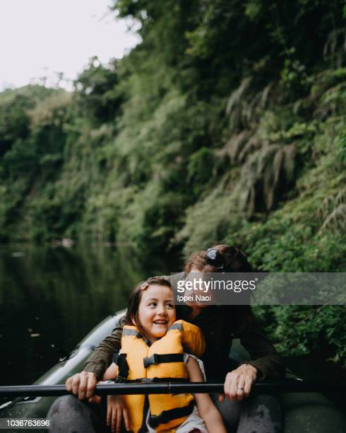 Mother and little girl having fun on inflatable raft