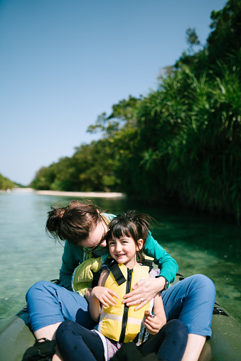 Mother and little girl having fun on kayak on clear tropical water, Ishigaki Island, Japan - gettyimageskorea