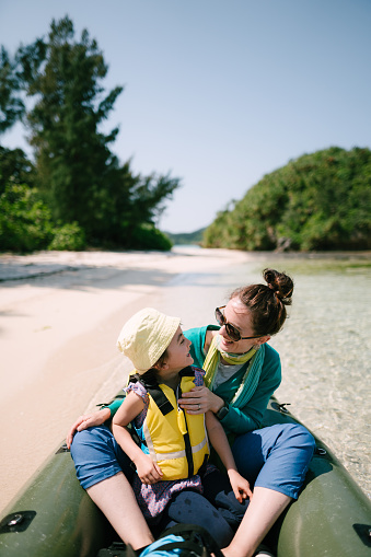 Mother and little girl having fun on packraft boat, Ishigaki Island, Japan - gettyimageskorea
