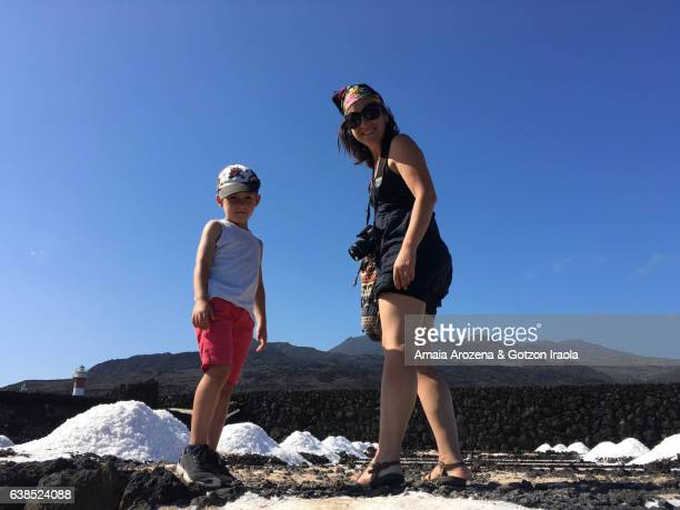 mother and little son in fuencaliente salt pans in la palma island, canary islands. spain - son la stock pictures, royalty-free photos & images