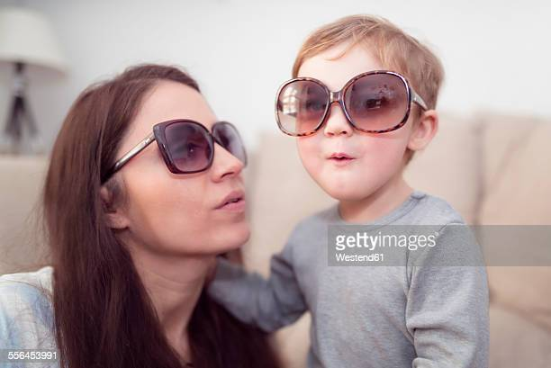 Mother and little son wearing sunglasses