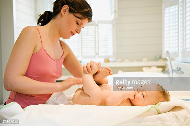 Mother and naked baby, milk cleanser