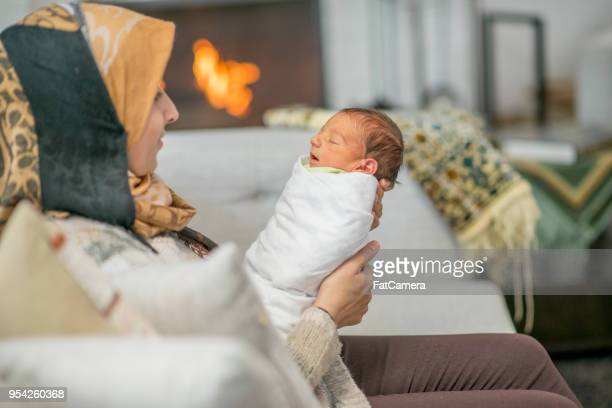 mother and newborn child at home on the couch - postpartum depression stock photos and pictures