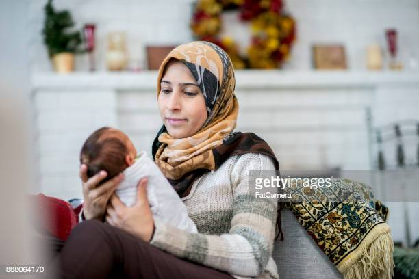 mother and newborn - muslim mother stock pictures, royalty-free photos & images