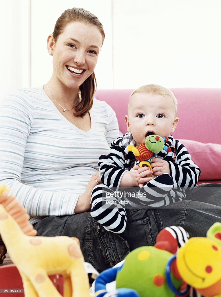 Mother and Offspring Sitting on a Sofa : Stock Photo