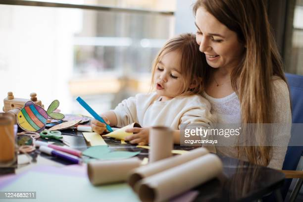 mother and preschool daughter learning and doing creative work - funny toilet paper stock pictures, royalty-free photos & images