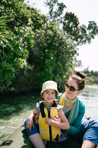Mother and preschool girl having fun on kayak on clear tropical water, Ishigaki Island, Japan - gettyimageskorea