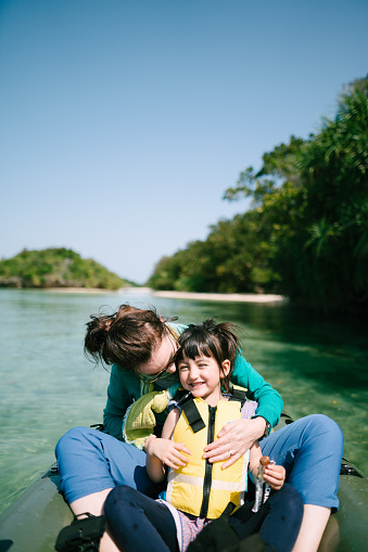 Mother and preschool girl having fun on kayak on clear tropical water, Ishigaki Island, Japan - gettyimageskorea