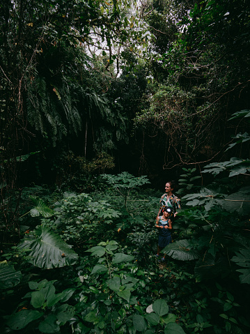 Mother and preschool girl hiking in jungle, Okinawa, Japan - gettyimageskorea
