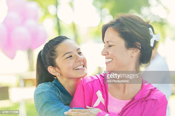Mother and preteen daughter at breast cancer awareness charity race