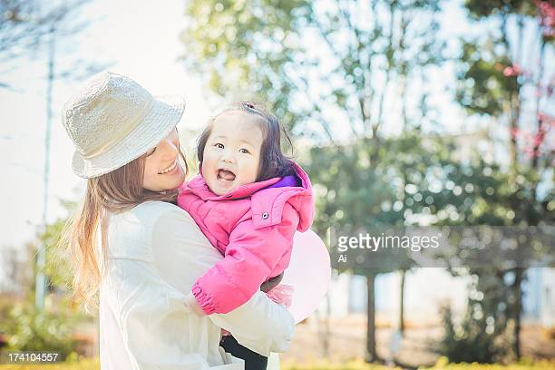 Mother and Smiling Baby Girl at the Park