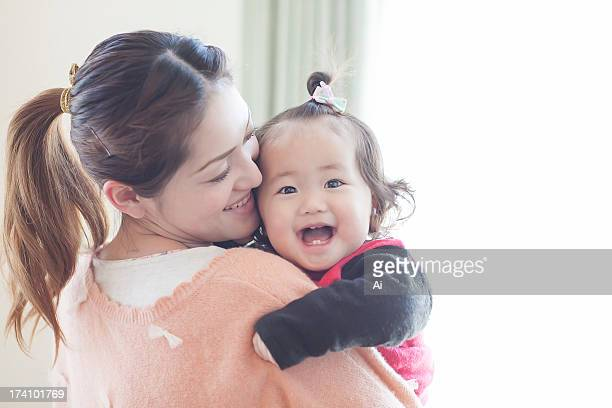 Mother and Smiling Baby Girl