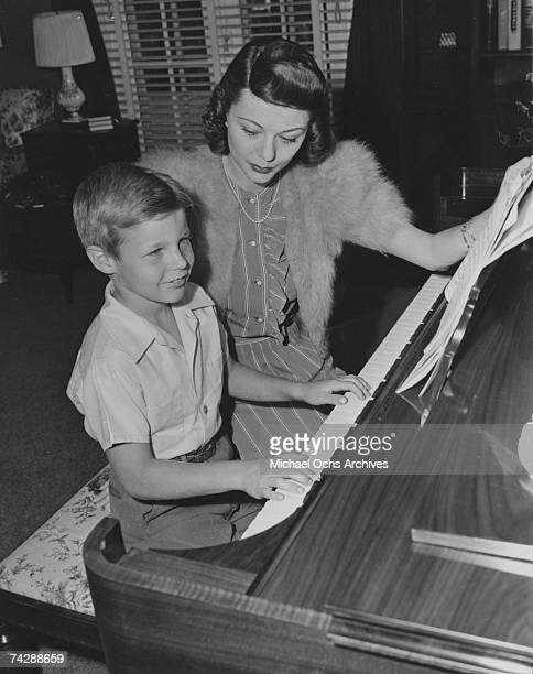 Mother and son actors David Nelson and Harriet Nelson work at the piano in circa 1942