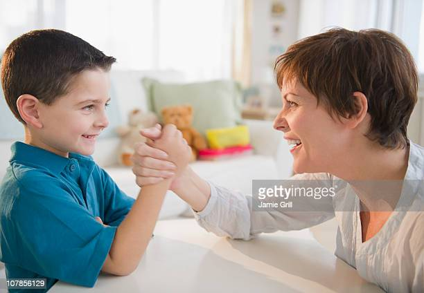 Mother and son arm wrestling