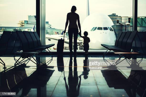 mother and son at airport - frankfurt international airport stock pictures, royalty-free photos & images