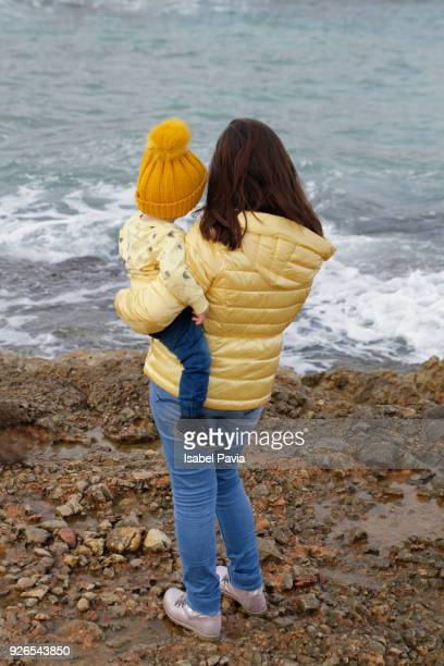 Mother And Son At Beach in Winter