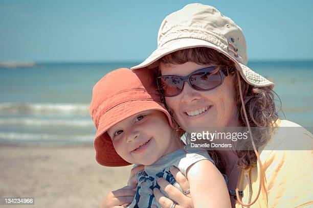 """mother and son at beach - """"danielle donders"""" stock pictures, royalty-free photos & images"""