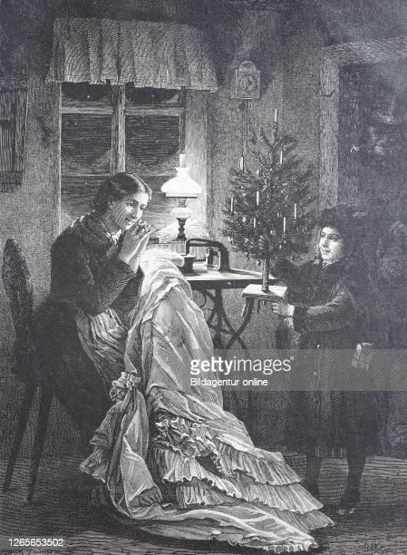 Mother and son at Christmas at home, she is sewing a dress / Mutter und Sohn zu Weihnachten zu Hause, näht sie ein Kleid, Historisch, digital...