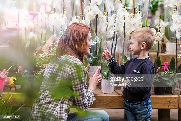 Mother and son at garden centre