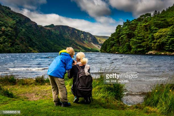 mother and son at glendalough upper lake - ring of kerry stock photos and pictures