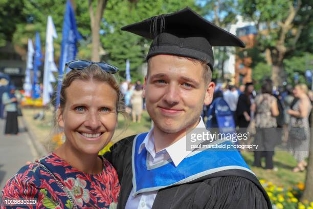Mother and son at graduation ceremony