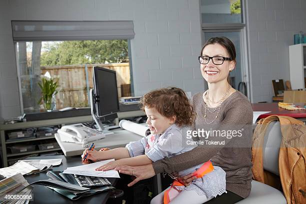 Mother and son at home office