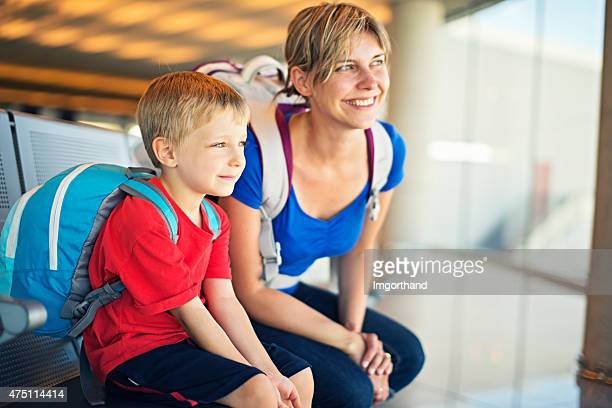 Mother and son at the airport
