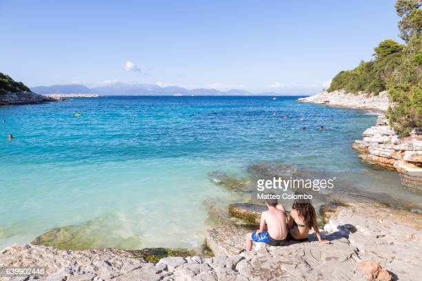 Mother and son at the beach in summer, Kefalonia, Greek Islands, Greece