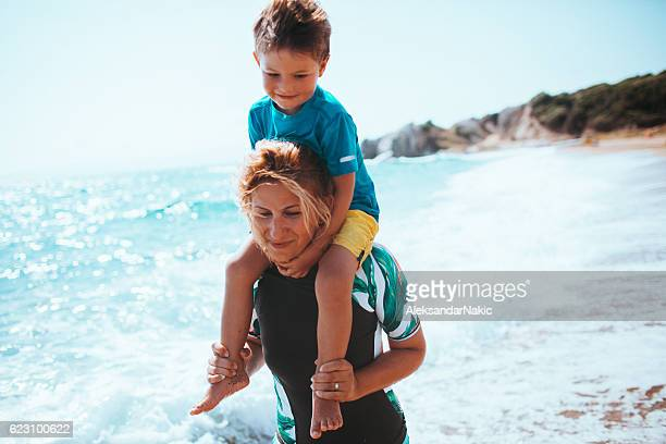 mother and son at the beach - mothers day beach stock pictures, royalty-free photos & images