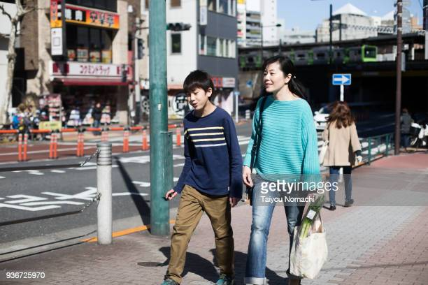 mother and son back from shopping - japan mom and son stock photos and pictures