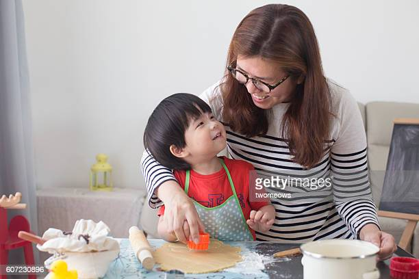 Mother and son baking together.
