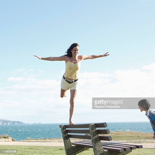mother and son bonding - standing on one leg stock pictures, royalty-free photos & images