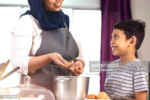 Mother and son bonding while baking a cake