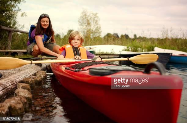 Mother and son (10-12) canoeing on lake, Staffel Lake, Murnau, Bavaria, Germany