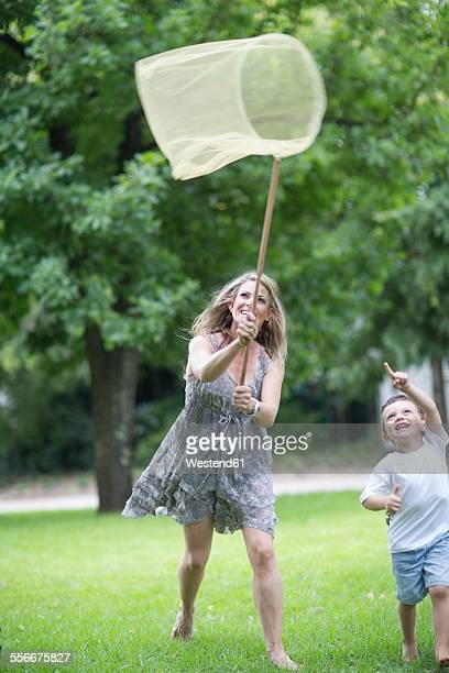 Mother and son catching butterflies with a net