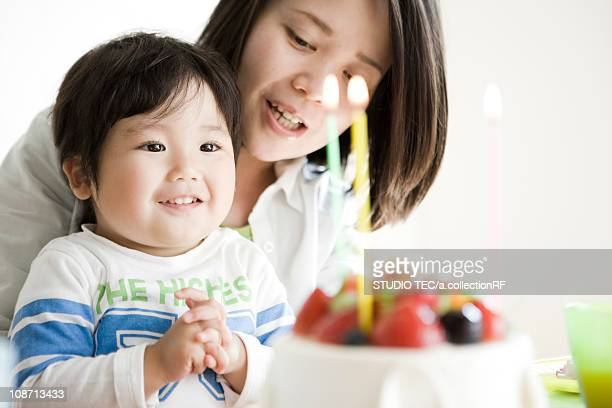Mother and son celebrating birthday