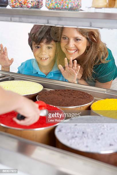 Mother and son choosing ice cream
