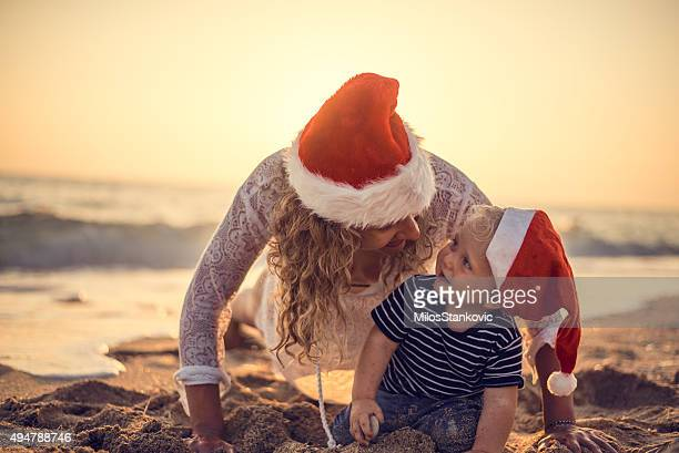 Mother and son Christmas time at the beach