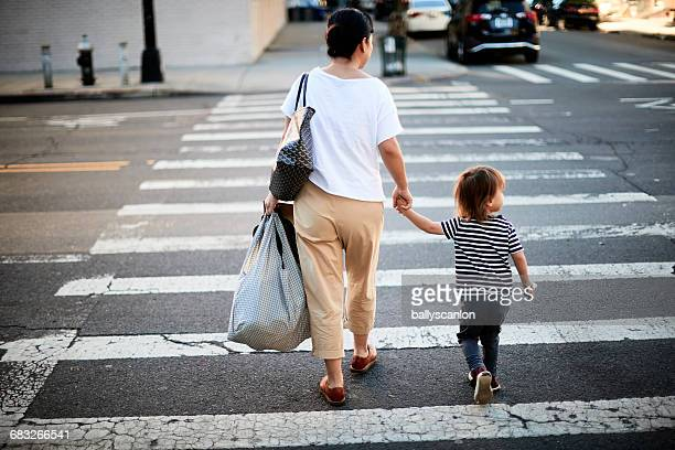 Mother And Son Crossing Street.