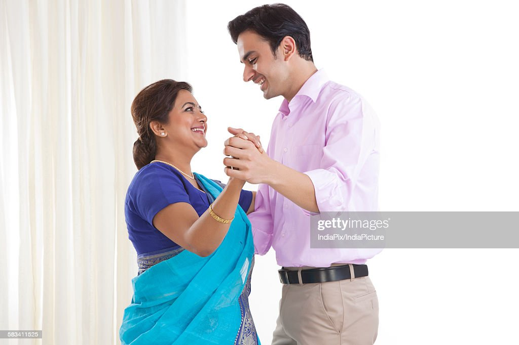 Mother and son dancing together : Stock Photo