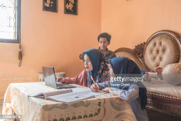 Mother and son daughter homeschooling