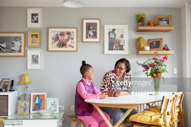 mother and son doing homework at dining table - {{ collectponotification.cta }} stock pictures, royalty-free photos & images