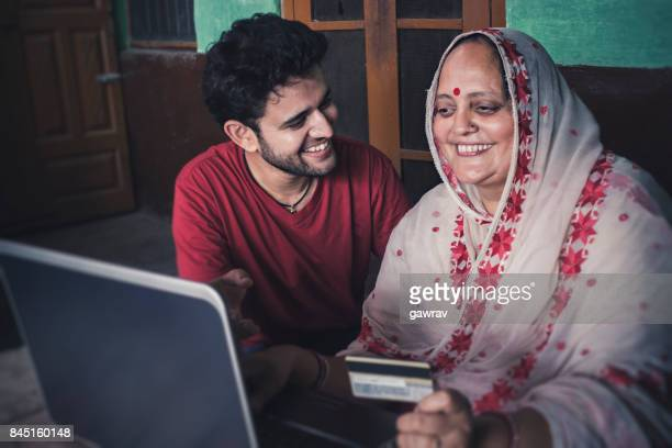 Mother and son doing online shopping at home.