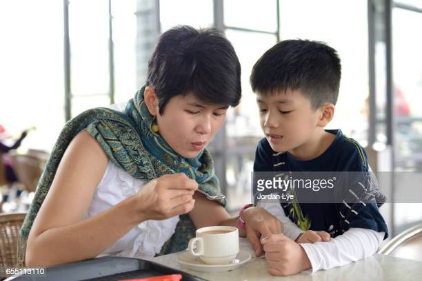 Mother and son drinking coffee