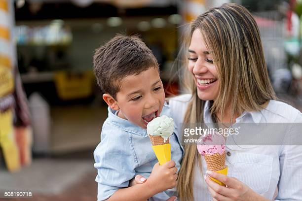 mother and son eating an ice cream - gelato italiano foto e immagini stock