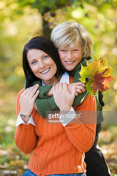 mother and son embracing, portrait - mid adult woman sweater stock pictures, royalty-free photos & images