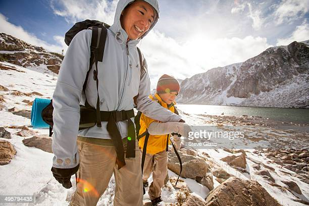 Mother and son enjoy a hike along a snow filled Gap Trail