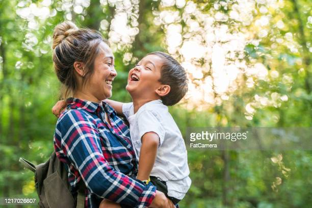 mother and son enjoy time in nature stock photo - family stock pictures, royalty-free photos & images
