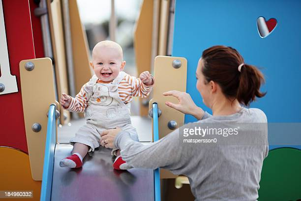 Mother and son enjoying an outdoor playground.